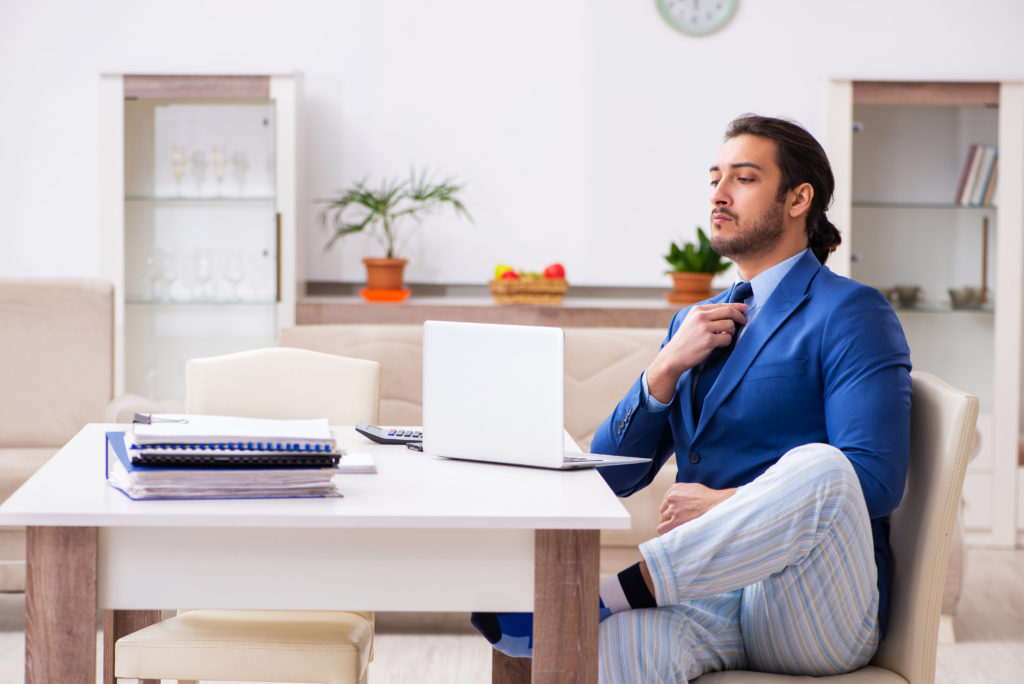 Man working from home in pajamas